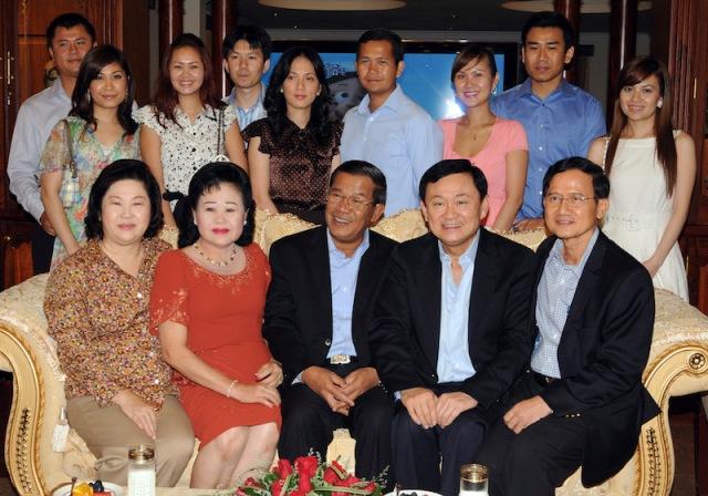 Ousted Thai Prime Minister Thaksin, former Thai Prime Minister Somchai and Cambodian Prime Minister Hun Sen pose with Hun Sen's extended family during their meeting at the latter's house in Phnom Penh