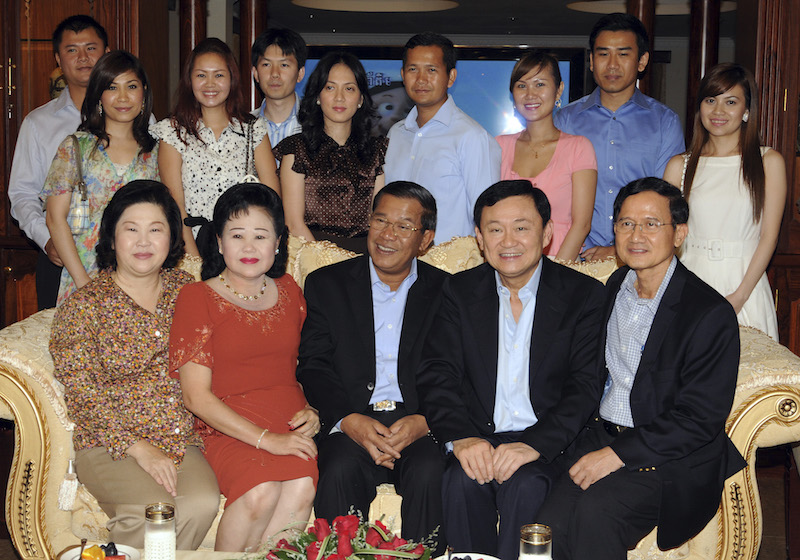 Ousted Thai Prime Minister Thaksin, former Thai Prime Minister Somchai and Cambodian Prime Minister Hun Sen pose with Hun Sen's extended family during their meeting at the latter's house in Phnom Penh
